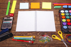 Opened blank notebook, frame of school supplies over a  retro wo Stock Photos