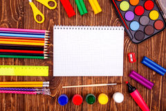 Opened blank notebook, frame of school supplies over a  retro wo Royalty Free Stock Image