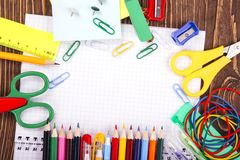 Opened blank notebook, frame of school supplies over a  retro wo Stock Photography