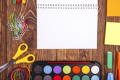 Opened blank notebook, frame of school supplies over a  retro wo Royalty Free Stock Photo