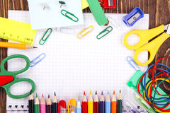 Opened blank notebook, frame of school supplies over a  retro wo Stock Image