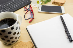 Opened blank notebook with pen, keyboard  and cup of coffee and cookies Stock Photos