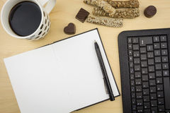 Opened blank notebook with pen, keyboard  and cup of coffee Stock Photos