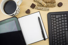 Opened blank notebook with tablet, pen, keyboard  and cup of coffee Stock Photos
