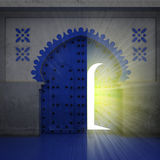 Opened blue doorway exploration with yellow glow Stock Photo