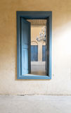 Opened blue wooden window with vintage plaster wall Royalty Free Stock Photos