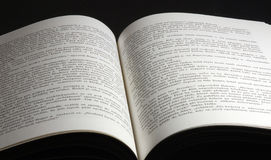 Opened book. On black background Royalty Free Stock Photo
