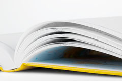 Opened book. Conceptual White Pages of the opened yellow book on a white background Stock Photo