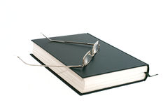 Opened book. Green book closed glasses, white background Stock Images
