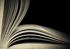 Opened book. Close-up of opened book pages against black background. Space for text. Shallow DOF Royalty Free Stock Image