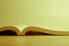 Opened book against blank background Royalty Free Stock Images