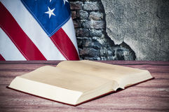e979bb79144f Opened book on a background of the USA flag. Open book on background of US