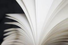 Opened book on black background Royalty Free Stock Image
