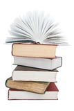 The opened book on a book pile. The opened book and book pile on a white background Royalty Free Stock Image