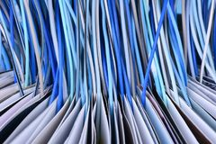 Opened book with computer network cables close-up, transfer information. And report news concept Royalty Free Stock Image