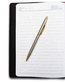 Opened book, diary and pen with blank pages isolat. Ed over white background close up royalty free stock image