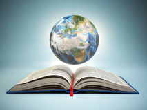 Opened book and Earth on blue background, Education concept. Royalty Free Stock Photo