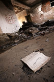 Opened book in front of satans' symbol. A picture of an old ruins with opened book in front and Satan's symbol painted on the wall Stock Photos