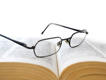 Opened book with glasses stock image