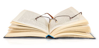 Opened Book And Glasses Royalty Free Stock Image
