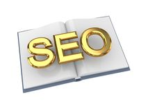 Opened book with golden word SEO. Stock Photo