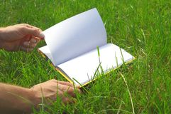 Opened book on the grass Royalty Free Stock Images