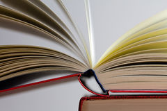 Opened book on gray background Royalty Free Stock Photo