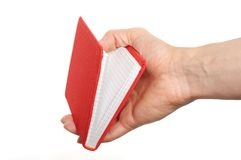 Opened book in hand Royalty Free Stock Photography