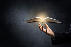 Opened book in hand Royalty Free Stock Photo
