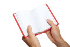 Opened book in hand Royalty Free Stock Photos