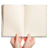 Opened book in hands Stock Photography