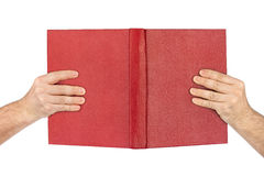 Opened book in hands Stock Image