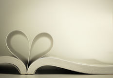 Opened book with heart page Stock Photography