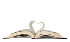 Opened book and heart shape stock photo