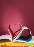 Opened book and heart shape Stock Images