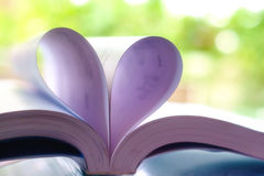 Opened book with heart shaped page stock photography