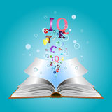 Opened book with letters Royalty Free Stock Photo