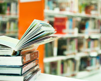 Opened book in library Royalty Free Stock Photography