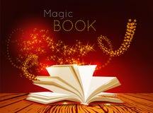 Opened book with magic light.  Stock Photos