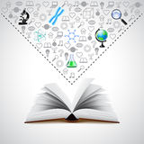 Opened book and many science icons above it Royalty Free Stock Photos