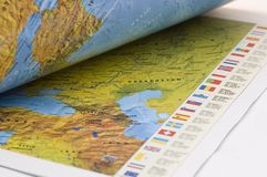 Opened book with map on it Royalty Free Stock Photo