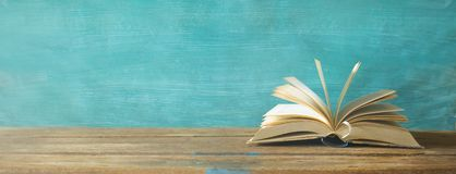 Opened book, panorama format, good copy space. Opened book, panorama format, good lighting good copy space on the painted background royalty free stock images