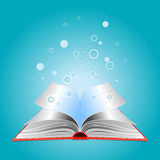Opened book with particles Royalty Free Stock Photos