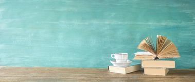 Opened book on a pile of books, panorama, reading education,literature. Good copy space royalty free stock photography