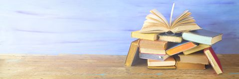 Opened Book on a pile of old books,copy space. Opened Book on a pile of old books, panorama, good copy space royalty free stock photos