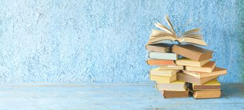 Opened Book on a pile of old books,. Panorama, good copy space royalty free stock images