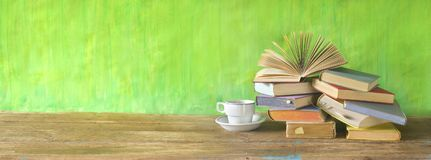 Opened Book on a pile of old books, panorama, good copy space. Reading,learning,literature,eduaction concept royalty free stock images