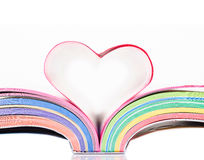 Opened book with sheets in the form of heart. Royalty Free Stock Photo