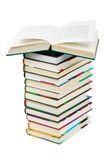Opened book on stack. Isolated on white background Stock Photo