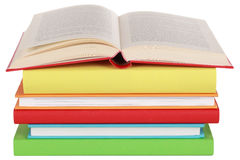 Opened book on a stack. Isolated on a white background Stock Photos